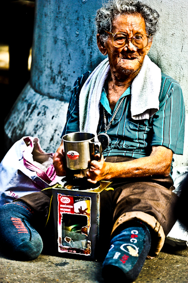 Handicapped Man Collecting Donations 2 - Bangkok, Thailand by Brett Howard Sproul. Giclee print of a handicapped man collecting donations, an original photo taken by Brett Howard Sproul.