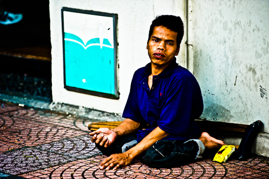 Handicapped Panhandler 4 - Saigon, Vietnam. Giclee print of a handicapped panhandler, begging, an original photo taken by Brett Howard Sproul.