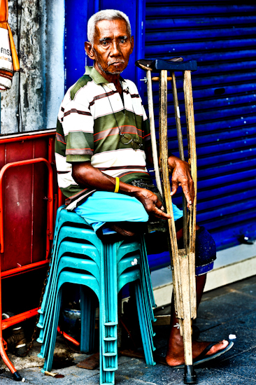 Handicapped Panhandler With Crutches - Bangkok, Thailand. Giclee print of a handicapped panhandler with crutches, begging in Bangkok, an original photo taken by Brett Howard Sproul.