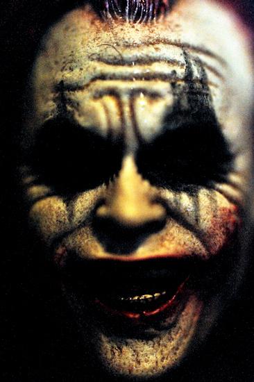 Joker (portrait HL3 red hair face front grainy)