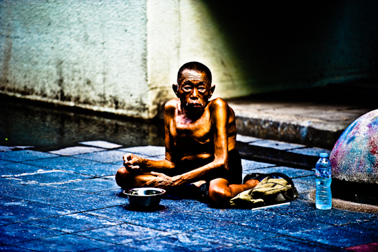 Deformed Man Begging - Bangkok, Thailand by Brett Howard Sproul.