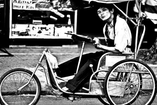 Handicapped Man On Bike - Saigon, Vietnam by Brett Howard Sproul