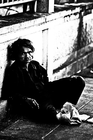 Homeless Man Sitting Against Wall - Bangkok, Thailand by Brett Howard Sproul